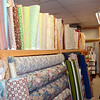 Manager Ivy Chirco looks across a row of vintage fabrics in the inventory at Newtown's Chintz-N-Prints. (Voket photo)