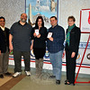 Local and divisional representatives of the Salvation Army honored four Newtown businesses Wednesday, February 25, with plaques of appreciation for allowing bell ringers outside their businesses each holiday season. Pictured, from left, are Newtown Chapter Salvation Army President Glenn Nanavaty, Yankee Wine & Spirits owners Matt and Ingrid DeAngelis, Dunkin' Donuts manager Jeff Dymerski, and Kathleen Orfitelli, director of volunteer services for the Southern New England Salvation Army division out of Hartford. Stop & Shop and Walgreens representative were unavailable for the ceremony. (Crevier photo)