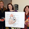 "As Newtown wound its way through the last week of Heart Month, regional Health District Director Donna Culbert, far right, didn't skip a beat hosting a ""Know Your Numbers"" screening for town and school district employees at the Newtown Municipal Center Tuesday, February 24. Besides helping municipal workers including Assistant Town Clerks Monica Duhancik, far left, and Aileen Nosal get familiar with their weight, blood pressure, cholesterol, and body mass index numbers, the health agency hosted a ""Go Red For Women"" awareness event earlier in the month, and supports a staff walking program around the Fairfield Hills campus during fairer weather. (Voket photo)"