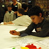 Middle Gate Elementary School student Fisher Stites began working on his corner of a mural on Feb-ruary 10. The mural will be one of nine created for the school's cafeteria. (Hallabeck photo)