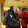 """Newtown High School senior Lilly Fulmer greeted Chen """"Summer"""" Hueying with a hug when delegation members visiting from Liaocheng, China, arrived at NHS on Monday, February 23. The delegation is staying until Wednesday, March 4. (Hallabeck photo)"""