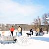 Dog owners perched at the top of a sloping hill at Newtown's Park and Bark stand relaxed in Sunday's surprise warmth. More than 40 degrees warmer that the minus seven degrees of two nights previous, pet owners were among many people stepping outside to soak in the sunlight Sunday. (Bobowick photo)
