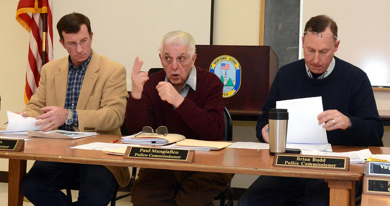 Police Commission Chairman Paul Mangiafico, center, makes a point at a February 3 Police Commission meeting. In its role as the local traffic authority, the commission is considering ways to alleviate traffic problems at the Main Street flagpole intersection. Also shown are commission members Joel Faxon, left, and Brian Budd, right.  (Gorosko photo)