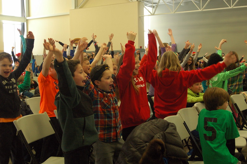 "Students at the assembly for St Rose of Lima School's Academic Olympics event on Friday, January 30, danced along after faculty began dancing to ""YMCA"" by the Village People. (Hallabeck photo)"