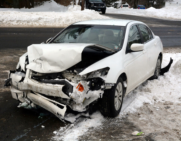 A two-vehicle accident that happened about 7:16 am on February 4 at the intersection of Mt Pleasant Road and Mt Pleasant Terrace caused travel delays during the morning rush. Police said the accident involved motorist Martin Basso, 23, of 21 Taunton Lake Drive, who was driving a 2006 Saab 9-3 sedan, and motorist Jennifer Duran, 18, of Danbury, who was driving a 2010 Honda Accord sedan, pictured. Police said Basso was injured in the accident. Details on how the collision occurred were not available from police before the deadline for this edition of The Bee. The Newtown Volunteer Ambulance Corps and the on-duty paramedic responded to the scene. Newtown Hook & Ladder firefighters also responded. Police said the accident is under investigation.                           (Gorosko photo)
