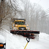 Town trucks and crew worked throughout the early morning hours and into the afternoon of February 2, plowing the streets including Great Quarter Road in Sandy Hook. (Bobowick photo)