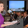 Cynthia E. Roy, CEO and president of Regional Hospice, addressed more than 100 supporters and officials who gathered for the grand opening and ribbon cutting ceremony at the new Center for Comfort Care & Healing in Danbury January 26. An exterior image of the facility can be seen projected in the background. (Voket photo)