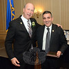Michael Kehoe, left, and Newtown Police Chief James Viadero socialized at Mr Kehoe's January 9 retirement party, after Chief Viadero had given Mr Kehoe a plaque from the International Association of Chiefs of Police in appreciation of Mr Kehoe's public service. Mr Kehoe retired as Newtown's police chief on January 6, with Chief Viadero starting work on January 7. (Gorosko photo)