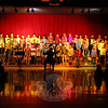 Head O' Meadow Elementary School fourth graders sang the Winter Chorus Concert performance for their fellow students on Tuesday, January 5, at a school assembly. Music teacher Cynthia Holberg, in silhouette, led the students through the performances. (Hallabeck photo)
