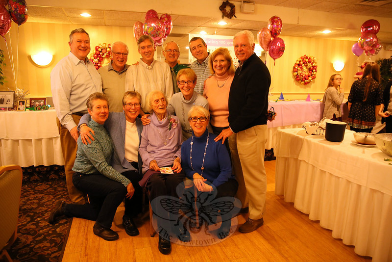 """Eleanore N. Farrell was surrounded by her family members at Roberto's Restaurant in Monroe on Saturday, January 9. She marked her 100th birthday two days later. Leo and Eleanore Farrell moved to Newtown from Stratford to raise their family, according to son Dennis Farrell. The pair had 12 children. Leo passed away in 1971. The family matriarch was honored on Saturday with cake, commemorative presents, and birthday cheer while surrounded by roughly 85 offspring. She has 27 grandchildren and 46 great-grandchildren. """"Happy birthday Gigi,"""" one great-grandchild said after the cake was presented. Pictured with Ms Farrell are her children. In front from left are Jeanne Farrell, Sharon Farrell, Norene Casey, and Pat Hough. Standing in the back from left are Michael Farrell, Peter Farrell, Jeffrey Farrell, Bill Farrell, Bryan Farrell, Eleanore Blewett, and Dennis Farrell. (Hallabeck photo)"""