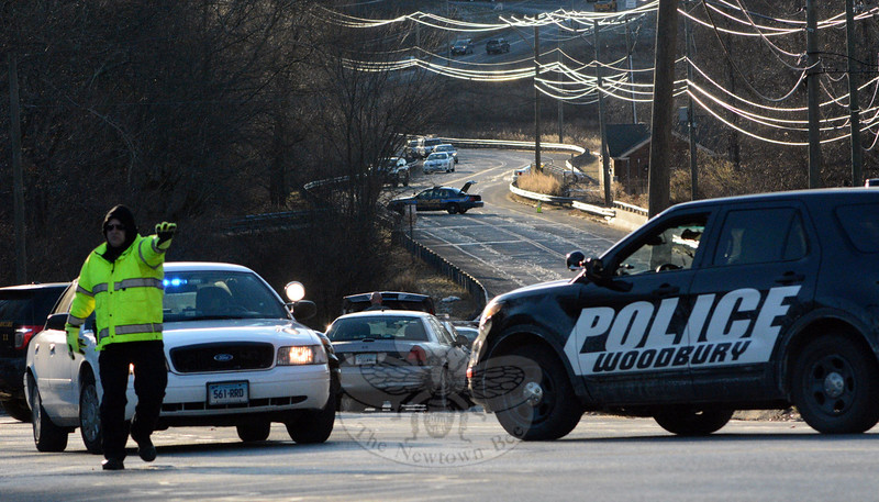 On Wednesday afternoon, police set up a roadblock to traffic on westbound Wasserman Way, near Exit 11 of Interstate 84, to prevent motorists from traveling near Oakview Road, where police were handling an emergency situation. (Gorosko photo)
