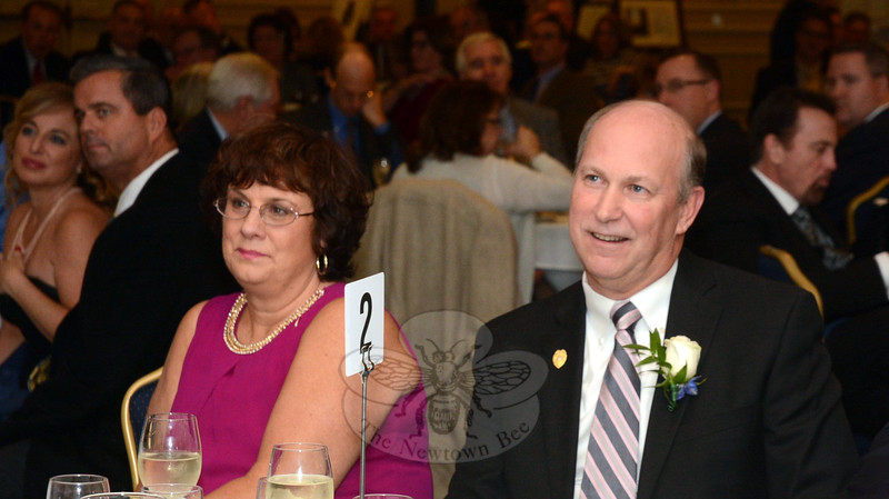 Michael Kehoe, right, and his wife Lori listened to a speaker at a January 9 retirement party held to honor Mr Kehoe. (Gorosko photo)