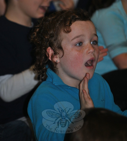 Lucy Thompson sings enthusiastically at the Hawley School Kindness Assembly, Tuesday, December 23. (Crevier photo)