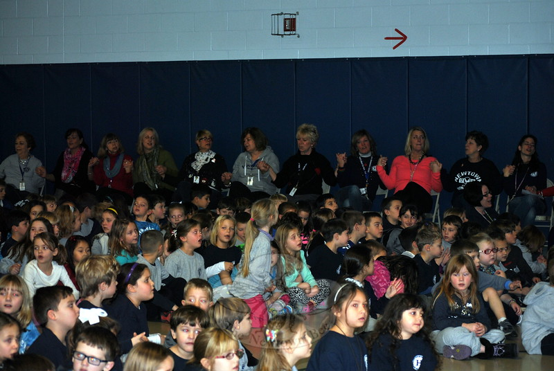 "Students, staff, and parents join together in singing ""Nothing More"" at the end of the Hawley School Kindness Assembly, December 23. (Crevier photo)"