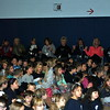 """Students, staff, and parents join together in singing """"Nothing More"""" at the end of the Hawley School Kindness Assembly, December 23. (Crevier photo)"""