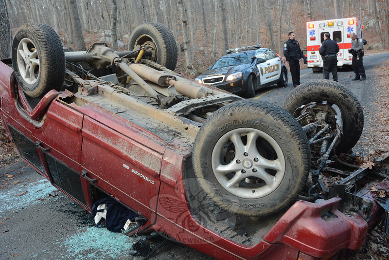 Police report that at about 3 pm on December 29, motorist Malcolm Dance, 17, of 188 Brushy Hill Road was driving a 1998 Jeep Cherokee SUV southward on New Lebbon Road, south of that road's in-tersection with High Rock Road, when the vehicle traveled off the right road shoulder, struck a tree and then rolled over onto its roof, landing in the middle of the road. Botsford and Sandy Hook firefighters responded. Police said Newtown Volunteer Ambulance Corps transported Dance to Danbury Hospital for treatment of minor injuries. The accident is under investigation. (Gorosko photo)