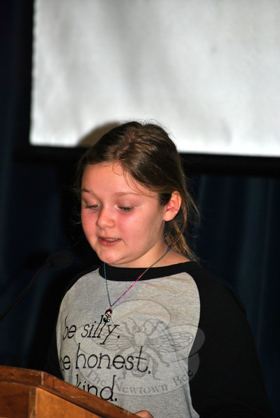 """Don't wait for people to be kind. Show them how,"" fourth grade reader Sydney Adolfson advised her peers. Hawley students wrote about or did five acts of kindness each, during the month of December. A Kindness Assembly was held on December 23. (Crevier photo)"
