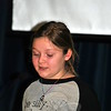 """""""Don't wait for people to be kind. Show them how,"""" fourth grade reader Sydney Adolfson advised her peers. Hawley students wrote about or did five acts of kindness each, during the month of December. A Kindness Assembly was held on December 23. (Crevier photo)"""