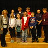 Reed Intermediate School Principal Anne Uberti, left, and teacher Maura Drabik, right, stood with the Reed National Geographic Bee finalists on Thursday, January 15. Student Anika Ledina, standing front center, earned a medal for her accomplishment. (Hallabeck photo)