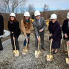 Residents and visitors exiting Interstate 84 onto Church Hill Road will soon see a new, aesthetically pleasing, Colonial-looking mini mart after company and local officials took part in the official groundbreaking for the planned Wheels gas station and mini mart being developed at the site by Connecticut-based Consumers' Petroleum. Among the participants are, from left, Newtown Director of Planning George Benson, Economic Development Coordinator Betsy Paynter, Economic Development Commission Vice Chair Elana Bertram, Consumers' General Manager of Construction and Facilities Jim Lantowski, First Selectman Pat Llodra, and Consumers' Petroleum owner Richard Wiehl. (Voket photo)
