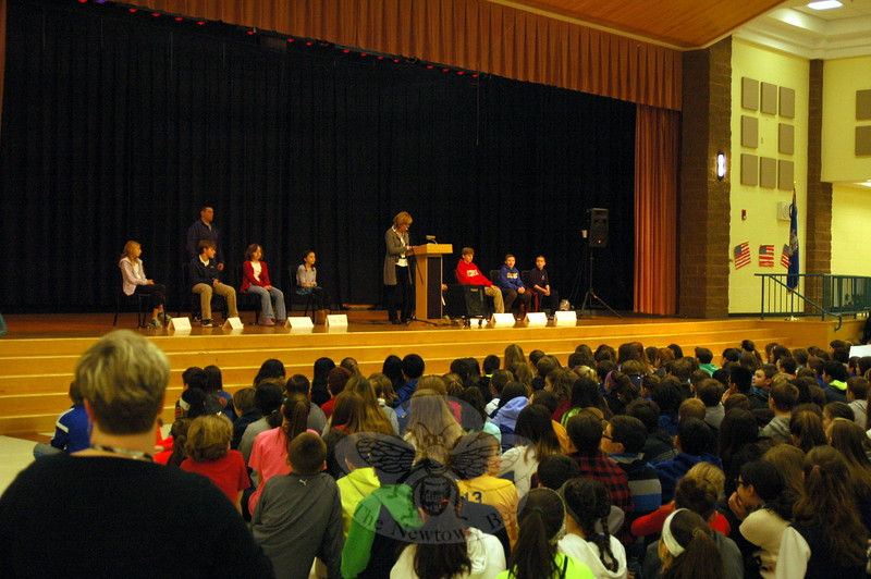 Reed Intermediate School Principal Anne Uberti read questions and directions for the final competition of the National Geographic Bee at her school during an assembly on January 15. (Halla-beck photo)