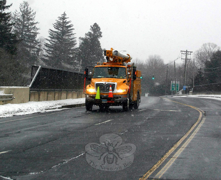 A CL&P truck travels west on Church Hill Road Monday afternoon. The utility company had crews stationed across the state by the time the worst of Winter Storm Juno arrived. Newtown was spared, however, with very few residents and businesses reporting power outages or issues from the storm.  (Hicks photo)