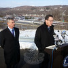 Connecticut Department of Transportation Commissioner James Redeker looks on as Governor Dannel P. Malloy addresses a small gathering of media representatives during a brief press conference held at the Interstate 84 Exit 2 Welcome Center on January 22. (Voket photo)