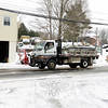 Dan Holmes of Holmes Fine Gardens drove his plow truck Tuesday in the early afternoon as the snowfall tapered off. (Bobowick photo)