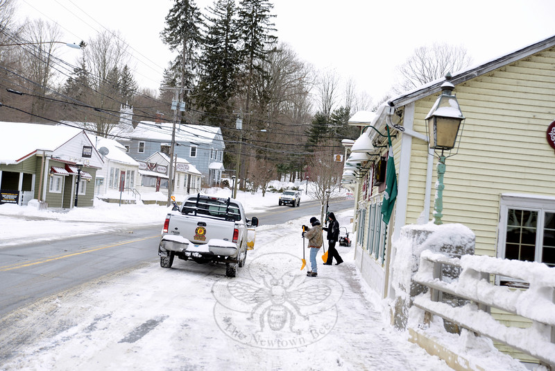 Throughout town snow-clearing efforts at homes and businesses began once the storm tapered away by midday. Michael Porco, Jr, and crews plowed drives and cleared walkways around downtown businesses in Sandy Hook Center. (Bobowick photo)
