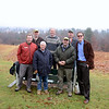 Gathered around a bench at Nettleton Preserve, which offers one of Newtown's most notable and highly photographed views of Main Street's flagpole and steeples, are Newtown Forest Association members who met to talk about an ongoing restoration project there. From left, back row, are NFA President Bob Eckenrode, Vice President Bart Smith, and member Tim Gagne; front row, David Boyle with Bartlett Tree Experts, the company that has provided planning, site supervision, and more for the Nettleton Preserve Memorial Tree Project, and NFA members Harvey Pessin, Guy Peterson, and Aaron Coopersmith. (Bobowick photo)