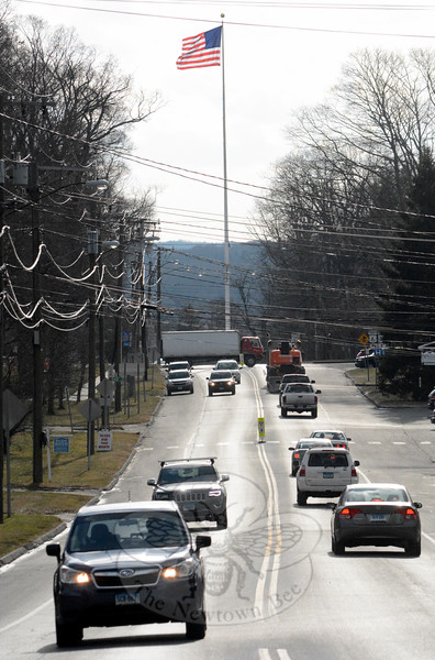 Looking southward on the heavily traveled Main Street toward the five-legged flagpole intersection of Main Street, Church Hill Road, and West Street. The Police Commission, in its role as the traffic authority, is considering ways to improve travel safety at the intersection. (Gorosko photo)