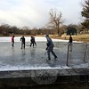 The cold snap that swept into the area with the new year firmed up the ice on Hawley Pond, attacking hockey players. This pick-up game took place on Wednesday afternoon. (Sherri Baggett photo)