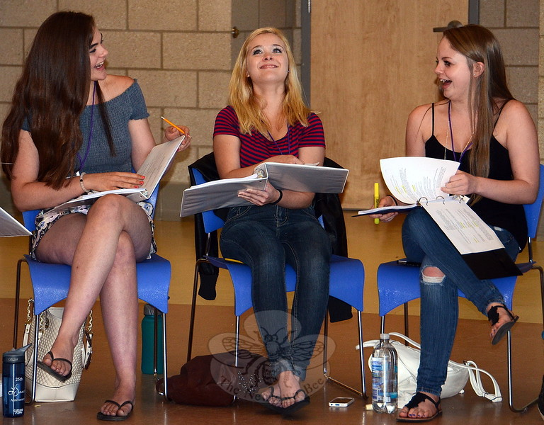 Kirsten Liniger, far left, is playing multiple roles in the NewArts summer musical Liberty Smith. During the cast's first read-through June 29, she joked with colleagues Brianna Bauch (Martha) and Lexi Tobin (Libby). (Voket photo)