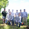 From left are NFA Treasurer Guy Peterson and President Robert Eckenrode, interns Matt Kras-nickas, Devin Peterson, and Doug Main, and NFA caretaker Dave Brooker. Kneeling in front are Bren-dan Peterson, left, and Sean Wallace. (Bobowick photo)