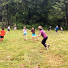 Mentor Karen Pettinelli, shown running center, plays tag with campers at Two Coyotes's Woodland Arts summer camp on Wednesday, July 1. (Cox photo)