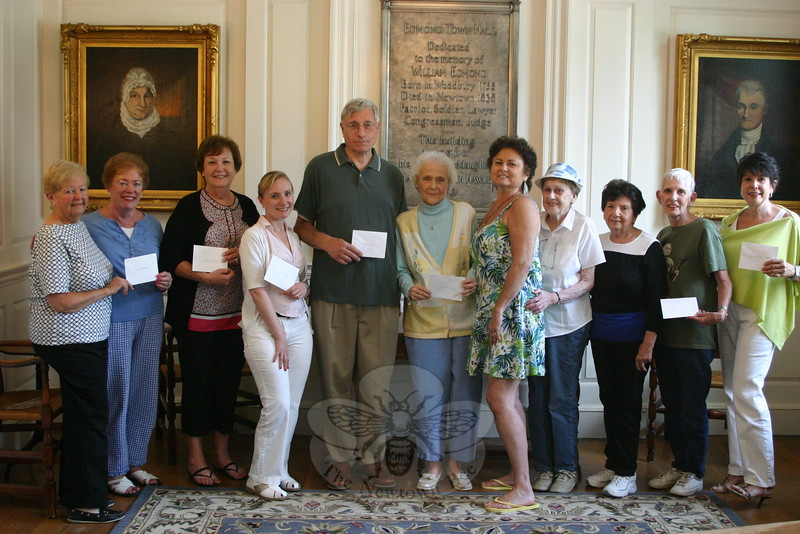 Newtown Woman's Club Finance Committee Chair Dolores Judge, left, and Club Tri-President Marie Sturdevant, second from left, presented checks to representatives from seven local organizations on June 25. Continuing left is Marg Studley, Samantha Flynn, Steve Bennett, Louise Andrews, Pat Murray, Shirley Glynn, Laura Hewitt, Barbara Lynch, and Beth Caldwell. (Hicks photo)
