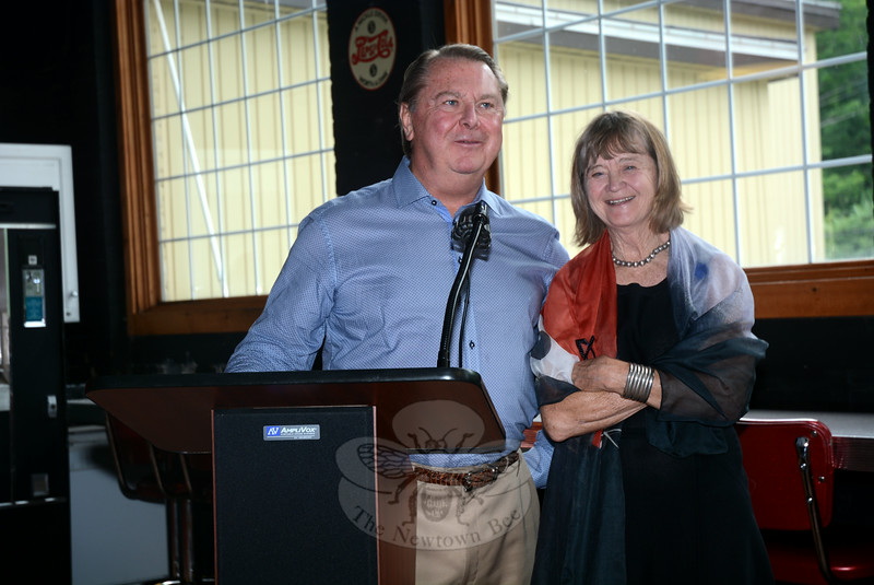Local businessman Don Droppo, Sr, left, and artist Lucy Lyon, who created the Sandy Hook Memorial sculpture, spoke at a June 29 reception at Curtis Packaging at which the sculpture was displayed. (Gorosko photo)