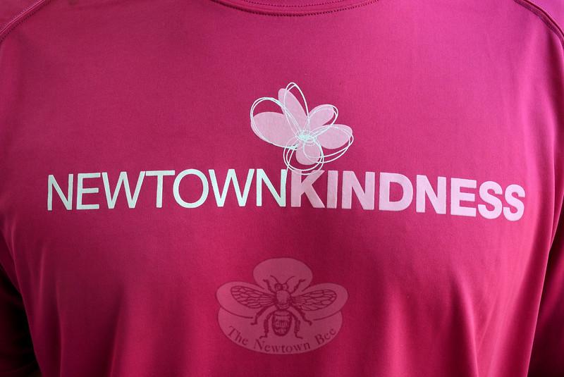 Newtown Kindness shirts bear a bold logo on a field of shocking pink. (Gorosko photo)