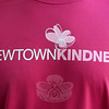 Newtown Kindness shirts bear a bold logo on a field of shocking pink. (Gorosko photo)