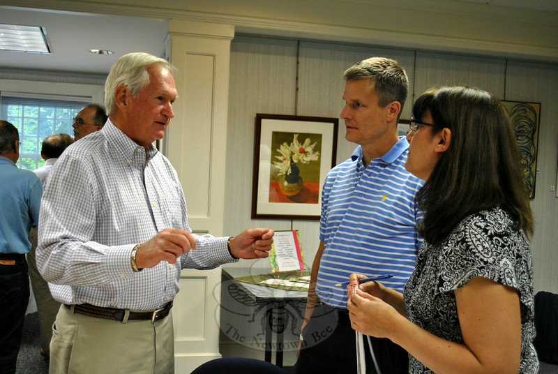 Newly elected C.H. Booth Library Board of Trustees President Bob Geckle, left, makes a point to newly appointed Library Director Brenda McKinley and board Treasurer Bill McCarthy before the regular meeting of the Board of Trustees, Tuesday, July 8. (Crevier photo)