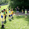 Children in Mrs Compton's class watch as classmates continue gently tossing water balloons back and forth. (Hicks photo)