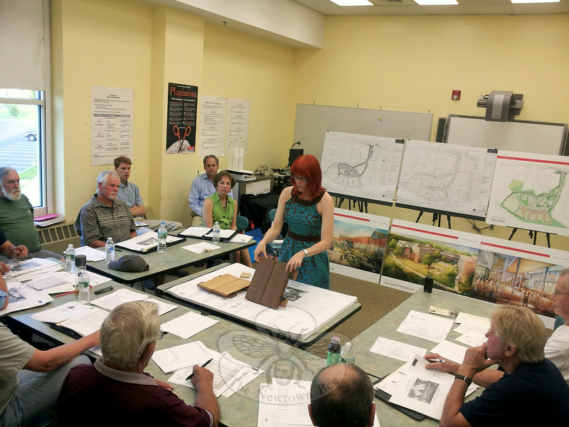 Julie McFadden of Svigals + Partners displays a sample of the wood facing being considered for the front of the new Sandy Hook School during a meeting of the Public Building and Site Commission July 8. The PBSC accepted a number of plans and cost estimates during the meeting and authorized sending those documents to the state for final review. (Voket photo)