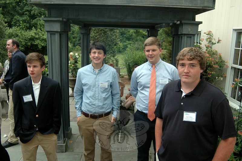 Award recipients attended a reception in their honor at the Dana Holcombe House. Those receiving scholarships from left, Cooper McLean, attending West Virginia University, was awarded the Lt Robert Vogel, USN Memorial; Gabriel Keogler, attending Franciscan University, was awarded the Smialowski Family Fund Honorary; Adam Hufziger, attending Loyola University, Maryland, was awarded the Daniel Barden Newtown Torpedo Memorial; and Sean Riley, attending Eastern Connecticut State University, received the Sandy Hook Volunteer Fire and Rescue award. (Sherri Baggett photo)