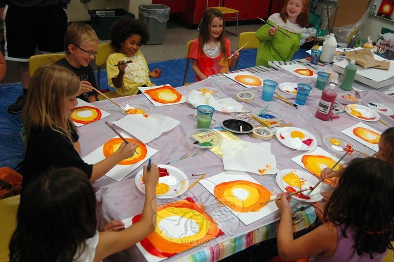 A painting class worked together at a table during the first week of Continuing Education's SMART camp program. (Fimmano photo)