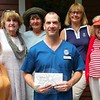 Members of the Newtown Visiting Nurse Association board flank Naugatuck Valley Community Col-lege instructor Sean Remson as he presents a check toward the association's scholarship initiative. Ac-cepting the donation are, from left, Anna Wiedemann, Carol Polcyn, Maureen McLachlan, Mary Ti-etjen, and Mae Schmidle. (Voket photo)