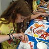 Annie Fowler worked on Wednesday, July 8, to decorate a cupcakes during the library's first Cupcake Wars event. (Fimmano photo)