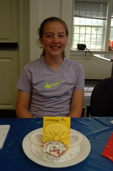 """Victoria Stevenson with her Cupcake Wars """"Albert Einstein"""" entry for Challenge 2 at the library. (Fimmano photo)"""