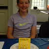 "Victoria Stevenson with her Cupcake Wars ""Albert Einstein"" entry for Challenge 2 at the library. (Fimmano photo)"