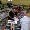 People scanned offerings in Reed Intermediate School's gymnasium during the first minutes of the book sale on Saturday. (Fimmano photo)