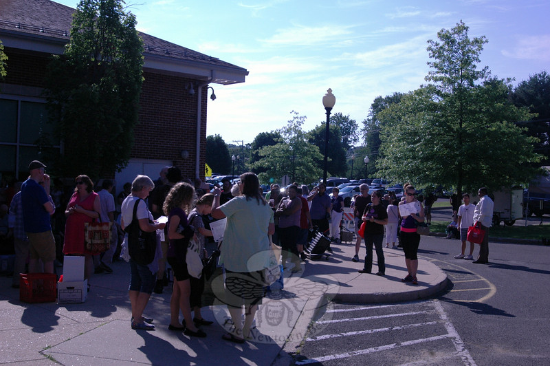 People stood in line outside Reed Intermediate School Saturday, July 11, waiting for the doors to open for the C.H. Booth Library's 40th Anniversary Annual Book Sale. (Fimmano photo)
